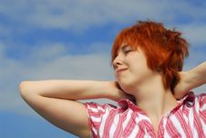 Woman With Red Hair On Blue Sky Background Stock Images