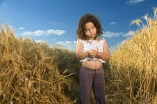 Free Little Girl In A Wheat Field Royalty Free Stock Image - 5096306