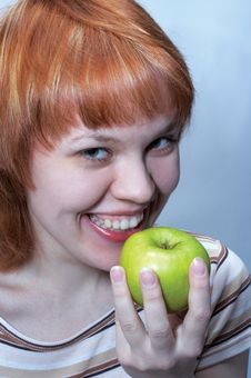 Free Red Haired Girl With Green Apple Stock Image - 517091
