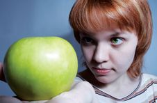 Free Red Haired Girl With Green Apple Stock Image - 517161