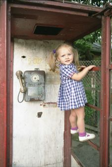 Free Pretty Girl In The Phone Booth Royalty Free Stock Photography - 517197