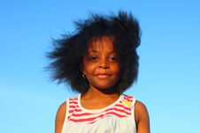 Girl On Blue Sky Royalty Free Stock Images