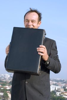 Free Businessman Biting Briefcase Royalty Free Stock Photos - 5107488