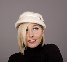 Blonde In Fur Hat Looking Up To Left Royalty Free Stock Images