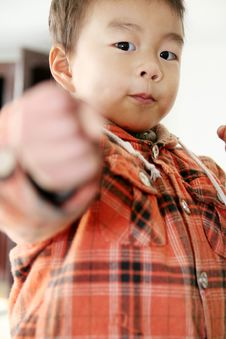Free Asian Boy Look At His Finger Royalty Free Stock Photo - 5113255