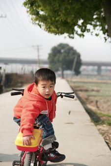 Free Asian Boy On His Bike Stock Photo - 5113270
