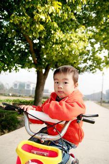 Free Asian Boy On His Bike Royalty Free Stock Photo - 5113275