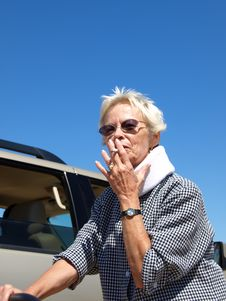 Woman Smoking Outside - 2 Royalty Free Stock Photos