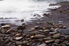 Free Pebbles At Shore Royalty Free Stock Photo - 5115305