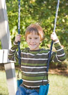 Free Boy Swinging Royalty Free Stock Photography - 5119727