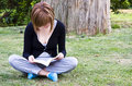 Free Young Woman Reading In The Park Royalty Free Stock Photography - 5125717