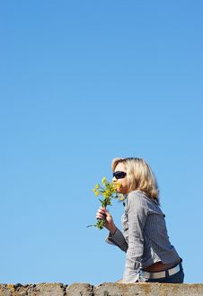 Free Girl Sniffing Flowers Royalty Free Stock Image - 5121116