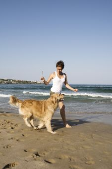 Free Young Girl And Dog Playing Royalty Free Stock Photos - 5122108