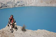 Trekker Sitting On Mountain Summit Stock Photography