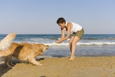 Free Yong Girl Playing With Her Dog Royalty Free Stock Image - 5122796