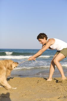 Free Yong Girl Playing With Her Dog Royalty Free Stock Photo - 5122845