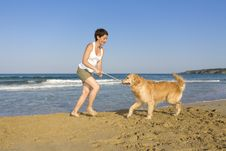Free Yong Girl Playing With Her Dog Royalty Free Stock Images - 5122859