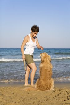 Free Yong Girl Playing With Her Dog Royalty Free Stock Image - 5122866