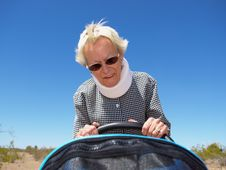 Free Grandmother Pushing Stroller In Desert Royalty Free Stock Photo - 5124795