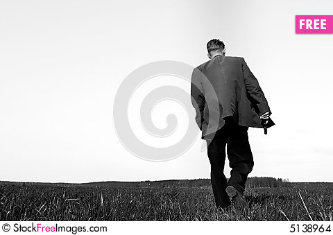 Walking gunman Stock Photo