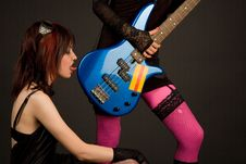Free Rock Girl Licking Bass Guitar Stock Photography - 5130312