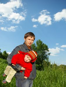 Free Father Holds Small Daughter Stock Photos - 5131763
