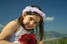 Free Girl Holding Red Roses Royalty Free Stock Photography - 5131877