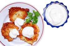 Free Potato Pancakes With Sour Cream Isolated On White Royalty Free Stock Photography - 5131987