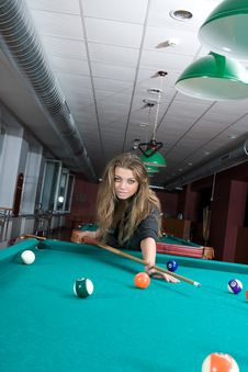 Free Girl In Short Skirt Playing Snooker Stock Image - 5133261