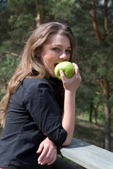 Young Girl With Apple Royalty Free Stock Images