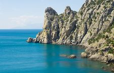 Free Blue Sea And Rocky Mountains - 3 Royalty Free Stock Photo - 5134705
