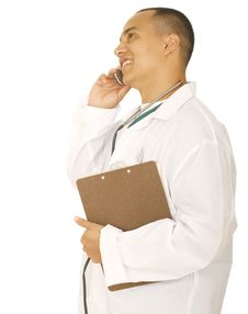 Free Busy Doctor Man On The Phone Royalty Free Stock Photo - 5134725