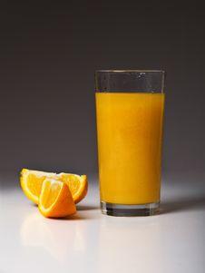Orange Segments And Juice Stock Photography