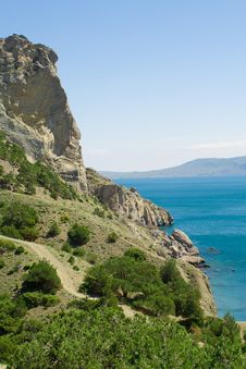 Free Blue Sea And Green Rocky Mountains Stock Photography - 5135032