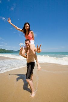 Couple Playful By The Beach Royalty Free Stock Photo