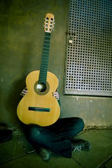 Free Young Person Behind Classic Guitar Stock Images - 5136144