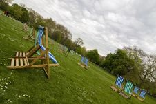 Free Empty Deck Chairs Under Impressive Cloudscape Royalty Free Stock Photography - 5136217
