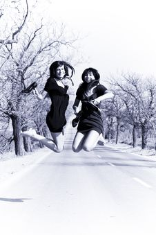 Free Happy Girls Jumping Royalty Free Stock Image - 5136236