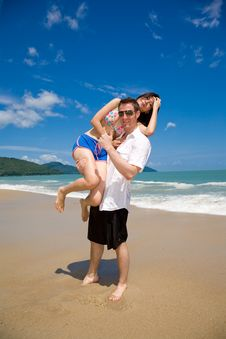 Free Lovers Having Fun At The Beach Royalty Free Stock Image - 5136536