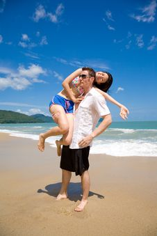 Free Lovers Having Fun At The Beach Stock Image - 5136551