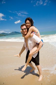Free Hunk Carrying Woman Piggyback Stock Photo - 5136620