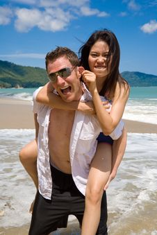 Free Playful Couple At The Beach Stock Photography - 5136692