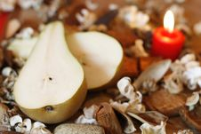 Free Burning Candle, Pear And Dried Plants Royalty Free Stock Photography - 5137087