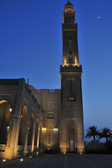 Minaret Of Mosque At Dusk Stock Photo