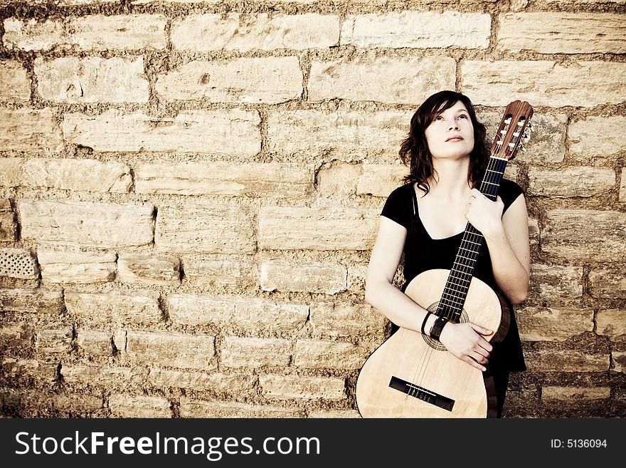 Street artist holding guitar