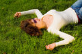 Free Girl Is Relaxing On The Grass Royalty Free Stock Photography - 5142037