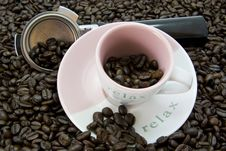 Coffee Beans With Cup And Saucer Royalty Free Stock Photo