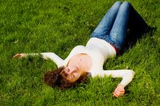 Free Girl Is Relaxing On The Grass Stock Photos - 5142023