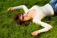 Free Girl Is Relaxing On The Grass Stock Photo - 5142030