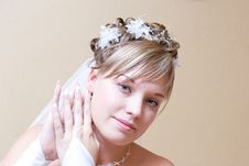 Free Bride Putting On Ear-ring Stock Image - 5142061